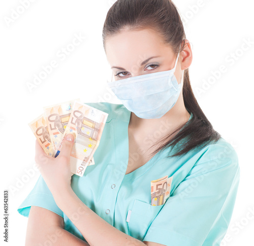 Female surgeon doctor holding money