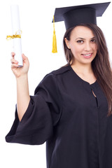 Beautiful woman student in graduation gown holding a diploma