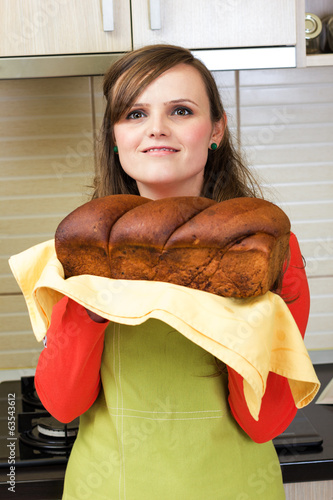 Young woman holding a traditional sponge cake