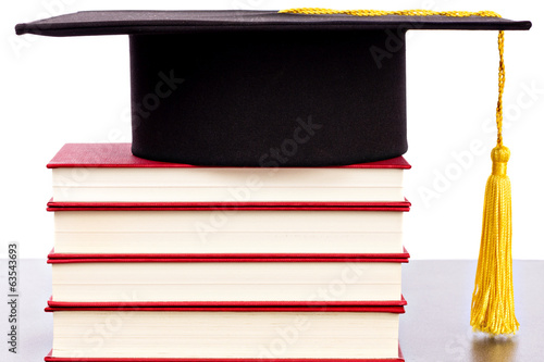 Graduation hat and books