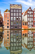 canvas print picture - Old buildings in Amsterdam