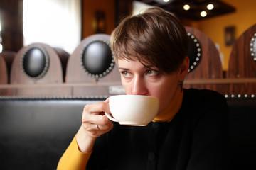 Woman drinks tea
