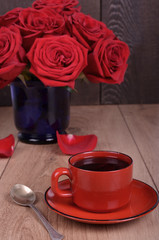 Bouquet of withered roses and coffee cup