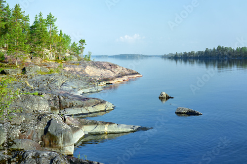Stony shore of Ladoga lake in the morning, Russia