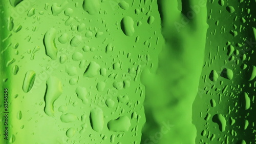 Water droplets on green glass. Macro.