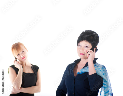 Two business women talking by cell phones