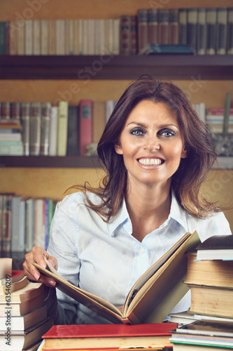 Smiling woman happy with books