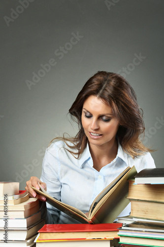 Beautiful woman relaxing with books