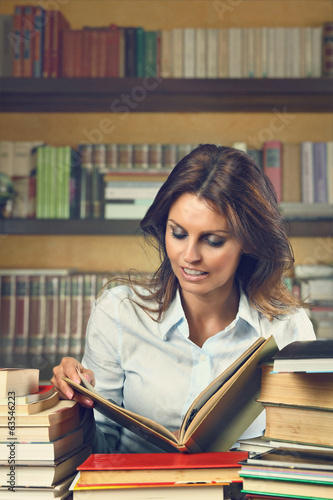 Beautiful woman happy among books