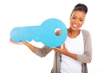 african american girl presenting a key symbol