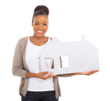 black woman holding paper house