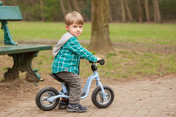 Two years old boy on a bike.