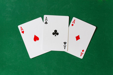 Three Ace background on the green background