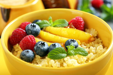 Porridge with berries and fruits - healthy breakfast.