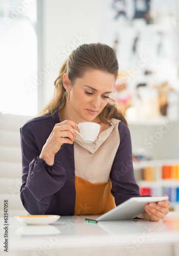 Fashion designer using tablet pc at work