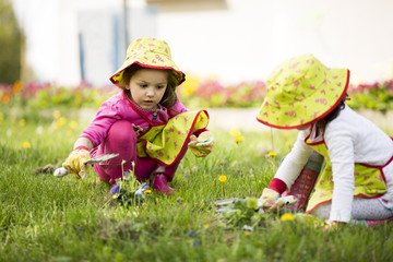 Little girls in the garden