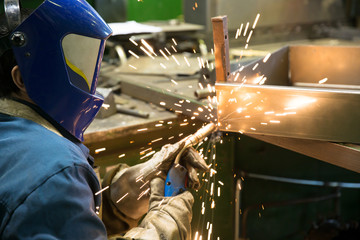 Industrial Welder during Welding  Works at Factory Workshop