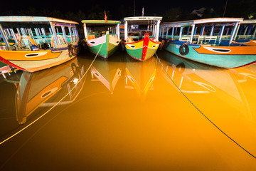 Boats at night in Hoi An, Vietnam, Asia.