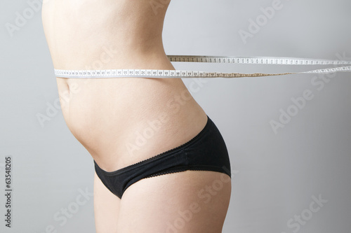 Female body with measuring tape