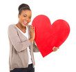 black woman holding red heart