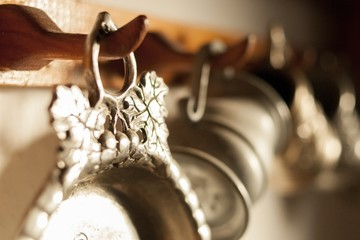 Old pewter dishes hanging on wall