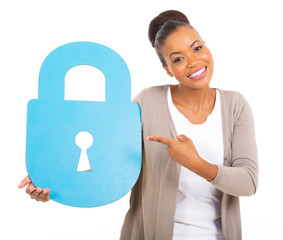 young african american woman pointing a large security lock