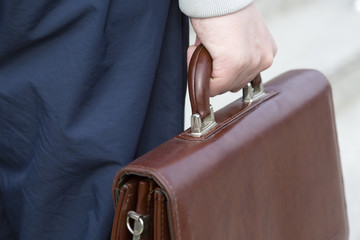 Businessman bears a suitcase