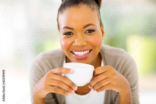african woman drinking coffee in the morning