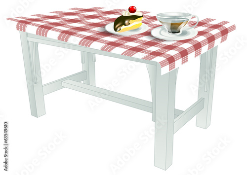 table with piece of cake and tea