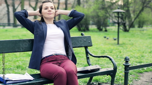 Businesswoman finish work on laptop and relaxing in the park