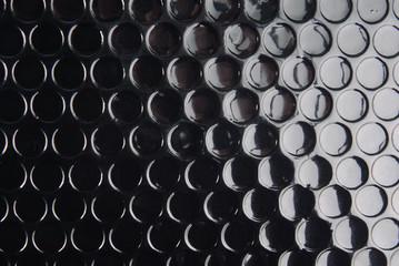 black circle textured background