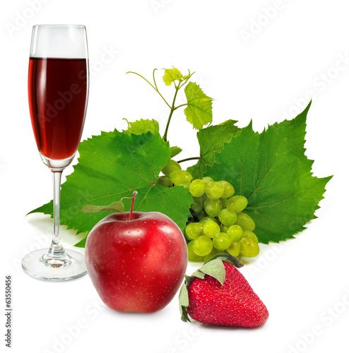 glass of wine, apples, strawberries and grapes