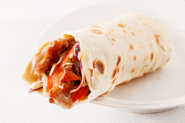 tortilla fajita wraps with meat and vegetables