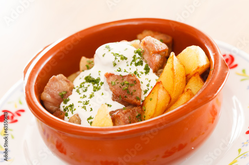 potatoes with meat in the pot