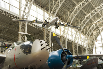 Vintage Airplane Inside A Hangar with Machine Gun on the Nose