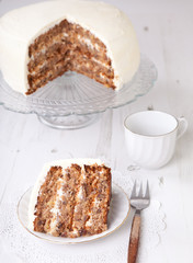 A piece of pecan cake with buttercream icing