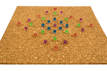 Colorful Pushpins In Corkboard