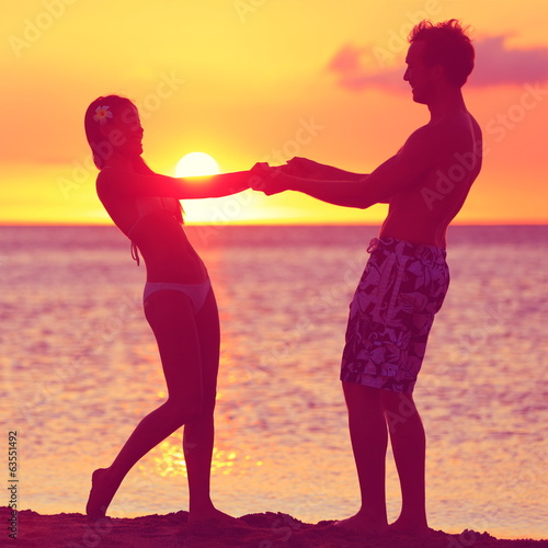 Lovers couple having fun romance on sunset beach