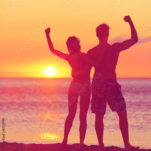 Winning success concept - happy beach couple