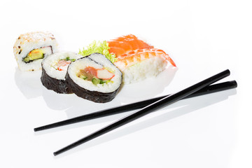 Sushi assortment on white background.