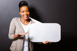 african woman holding speech bubble