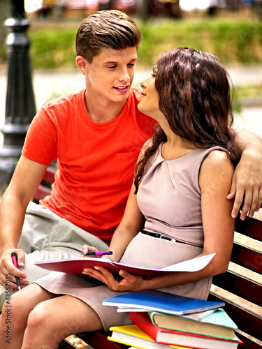 Couple student with notebook outdoor.