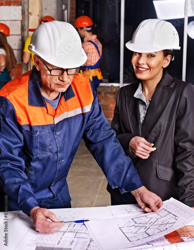 Business woman in builder helmet .