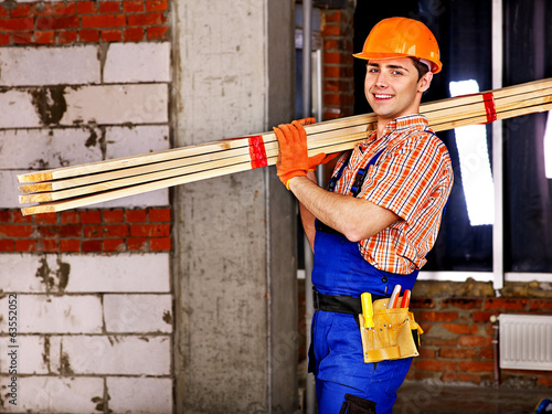 Man in builder uniform.
