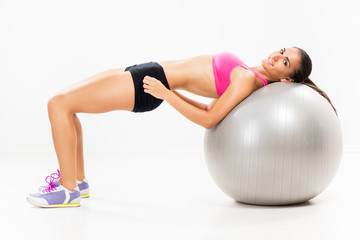 Exercising and lifting the weights with Exercise Ball