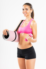 Fitness woman with exercise mat and dumbbells