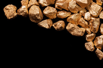 Gold nuggets on black background.
