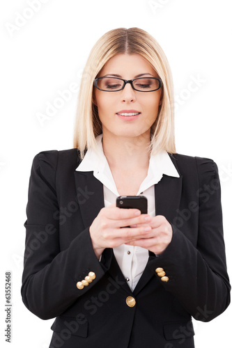 Businesswoman with mobile phone.