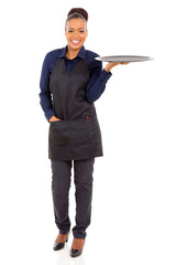 african waitress holding empty tray