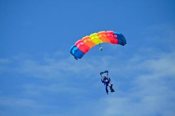 Skydiver in blue sky